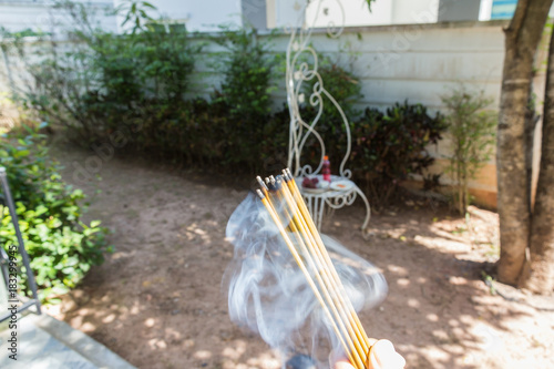 Fotografia, Obraz incense burn with smock with food for workship at outside home