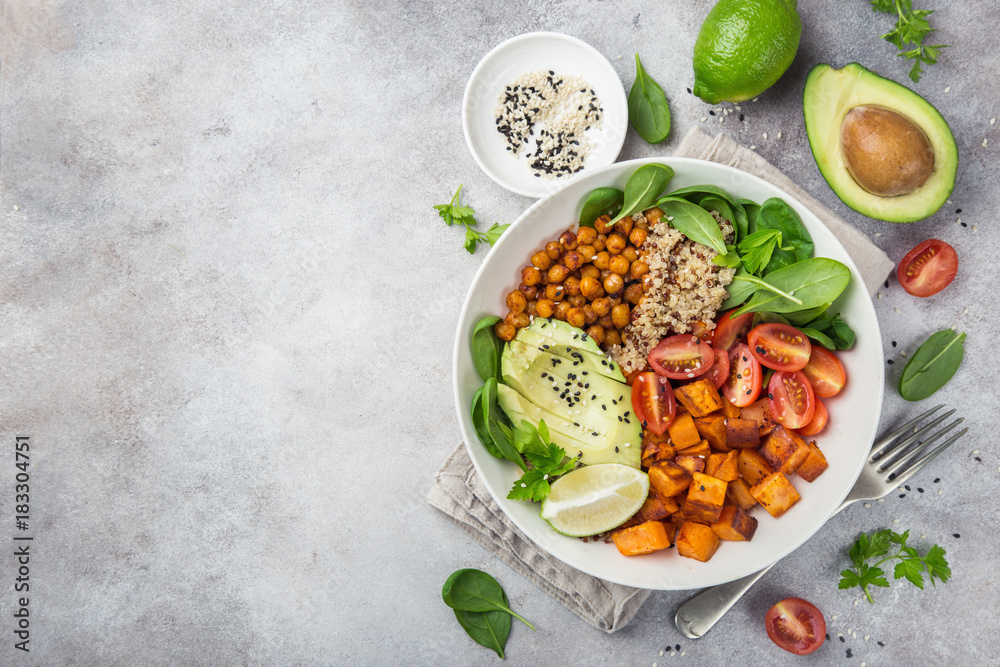Fototapety, obrazy: healhty vegan lunch bowl. Avocado, quinoa, sweet potato, tomato, spinach and chickpeas vegetables salad