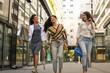 Young women after shopping walking street.