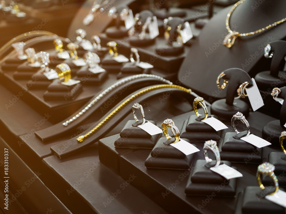 Fototapeta Gold jewelry diamond shop with rings and necklaces luxury retail store window display