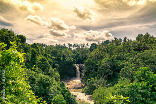 Canvas-taulu magical and bucolic eden waterfall evening in bali. tegenungan.