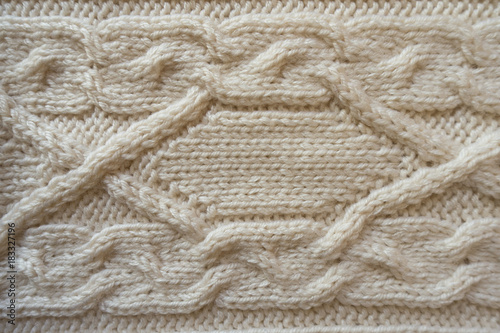 Fotografie, Obraz  White handmade knitwork with horizontal braid pattern from above