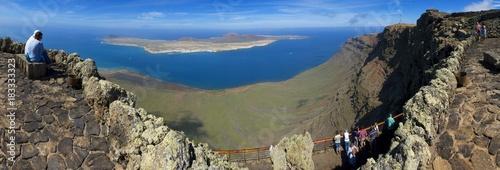 Fotografia  Unrecognizable people admiring breathtaking view from Mirador del Rio, Lanzarote