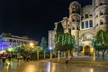 Fototapeta na wymiar Christmas light decorations around the cathedral in Malaga, Spain