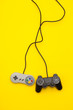 canvas print picture - Retro computer gaming controllers on a bright yellow background