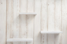 Set Of Wooden Shelves On Wall Background