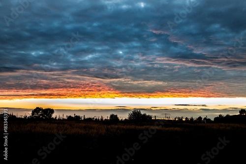 Spoed Foto op Canvas Zee zonsondergang Himmelrot