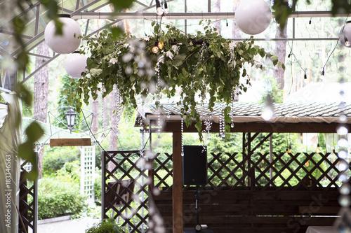 Fotobehang Bloemen Fresh nature herb bouquet composition on a ceiling with a glass decor. Wedding bridal decorations. Dim dark sunset light. Romantic mood