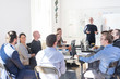canvas print picture Relaxed informal IT business startup company meeting. Team leader discussing and brainstorming new approaches and ideas with colleagues. Startup business and entrepreneurship concept.