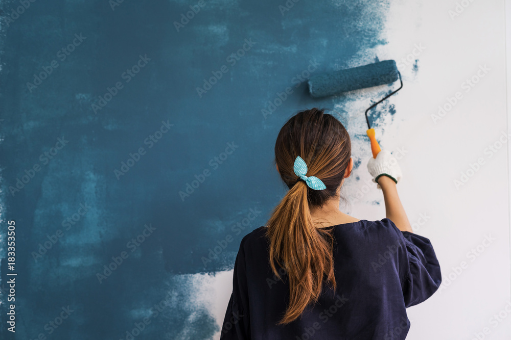 Fototapety, obrazy: Young asian happy woman painting interior wall