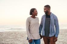 Smiling African Couple Walking...