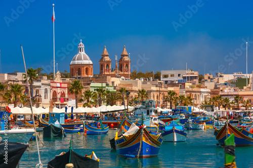 Poster de jardin Europe Méditérranéenne Traditional eyed colorful boats Luzzu in the Harbor of Mediterranean fishing village Marsaxlokk, Malta