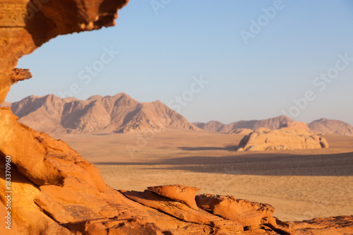 Spoed Foto op Canvas Oranje eclat A rock formation during sunset in Wadi Rum, Jordan