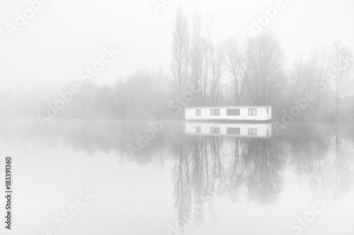 Desolate houseboat in the fogg on the ringvaart in Amsterdam,. Fototapete