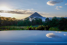 Coned Shaped Volcano At Dawn W...