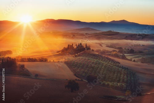 Deurstickers Toscane Tuscany, panoramic landscape with famous farmhouse rolling hills and valleys in beautiful golden morning light at sunrise in summer, Val d'Orcia, Italy