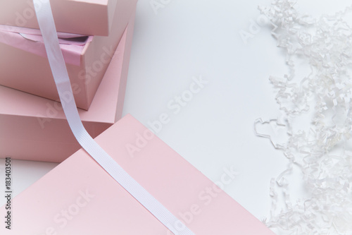 Fotografia, Obraz  Christmas gift wrapped in pink boxes and ribbon on white