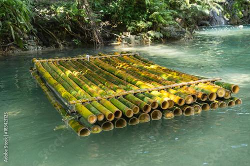 Bamboo raft in river. Selective focus.