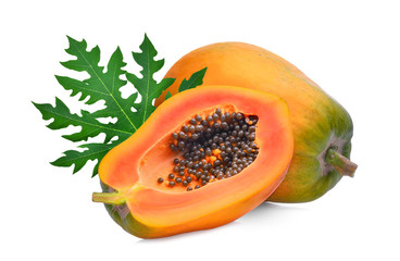 whole and half ripe papaya with green leaf isolated on white background
