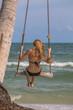 Girl with bikini on swings