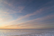 Winter nature landscape. Sunset over the frozen Ob sea.