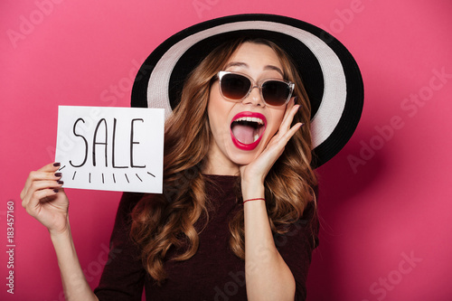 Portrait of a cheerful pretty girl wearing hat