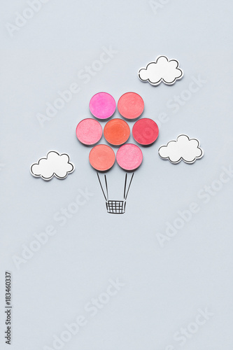 Beauty in the sky / Creative concept photo of aerostat made of cosmetics on grey background Canvas Print