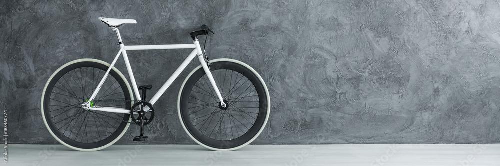 Fototapeta White bicycle against concrete wall