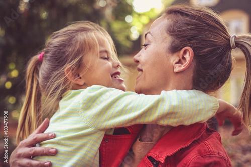 Fotografie, Obraz  Mom give me a hug, little girl with mother.