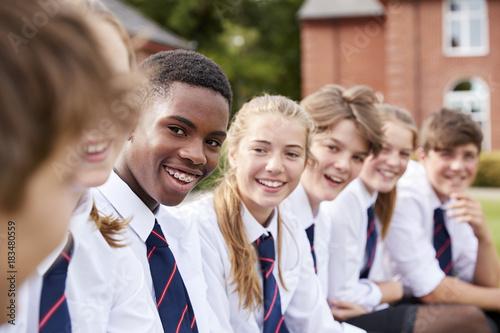 Group Of Teenage Students In Uniform Outside School Buildings Fototapet