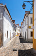 The view of cozy narrow street of Evora. Portugal