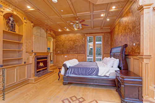 Welcoming Mansion Bedroom With A Rustic Wood Coffered