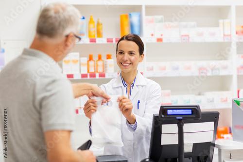 Poster Pharmacie apothecary selling drug to senior man at pharmacy
