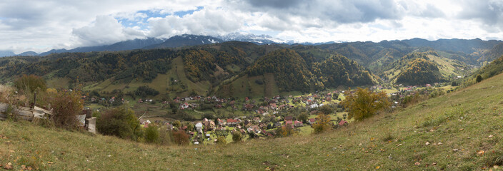 Fototapeta na wymiar Panorama  of the valley with the villages at the foot of the Carpathian Mountains not far from the city of Bran in Romania