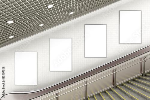 Blank advertising poster on underground escalator wall Wallpaper Mural