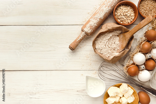 Fotografía Baking background with eggs and flour on white rustic wood