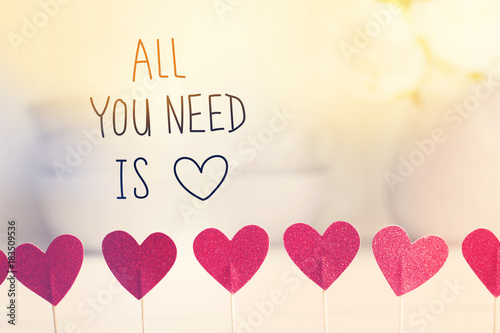 Photo  All You Need Is Love message with small red hearts with white dishes