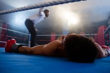 Unconscious Boxer Lying By Ref...