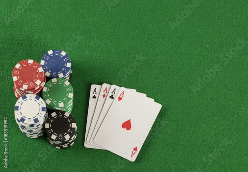 Платно  poker game with chips on green background