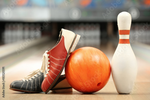 Fotografia, Obraz  Shoes, pin and ball on floor in bowling club