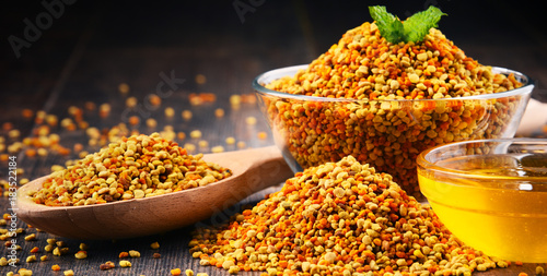 Fotografering Bowls with bee pollen and honey on kitchen table
