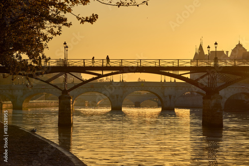 Sunrise over the Pont des Arts, Pont Neuf and the Seine River banks Canvas Print