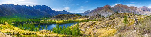 Panorama, mountains and mountain lake. Taiga, Altay, Russia.