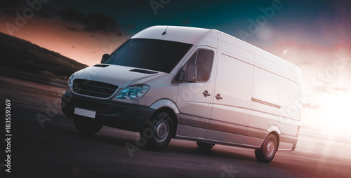 White van for freight haulage on a freeway Fototapeta