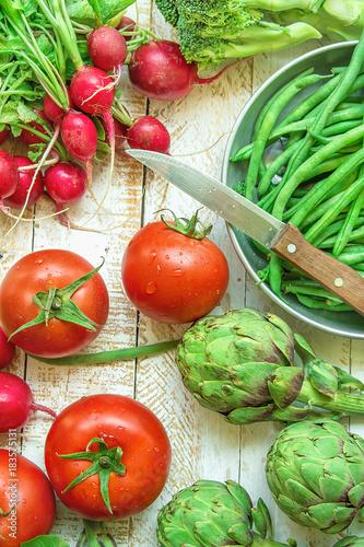 Fresh Organic Vegetables Artichokes Green Beans Tomatoes Red Radish Broccoli on Wood Garden Kitchen Table Vegan Clean Eating Mediterranean Diet Preparing ...