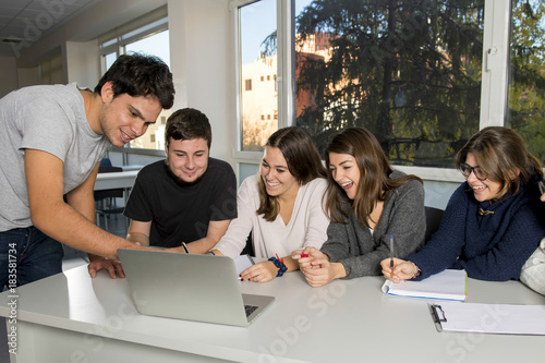 Fotografía  group of young male and female teenager university students at school sitting on