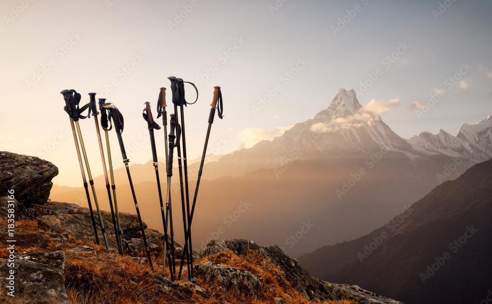 Fototapety, obrazy: Trekking sticks on mountain top background