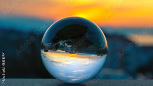 Fototapety, obrazy: Playing with glass sphere. Catching sunrise in a sphere from my balcony in Rijeka.