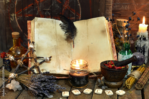 Old witch book with empty pages, lavender flowers, pentagram and witchcraft objects Fototapeta