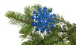 blue snowflake with branch of Christmas tree isolated on white background